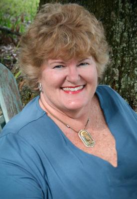 Rev Michele Grace Lessirard headshot-275x399